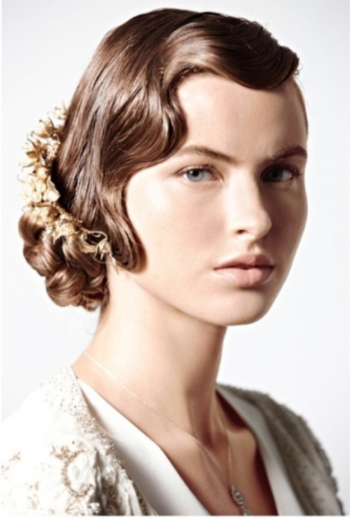 a side updo on medium hair done with a wavy front and a gold hairpiece looks really cool and wow
