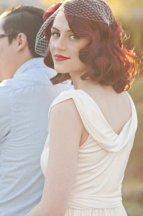 vintage curls on medium length hair of a bold burgundy shade look both modern and timelessly elegant