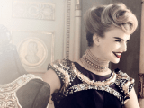 a curled and fixed vintage updo with volumes on top looks very stylish and perfectly stylized