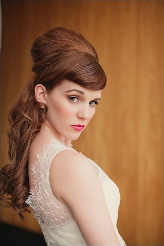 a retro hairstyle with long hair, a large volume on top and a curled front is a statement and bold idea