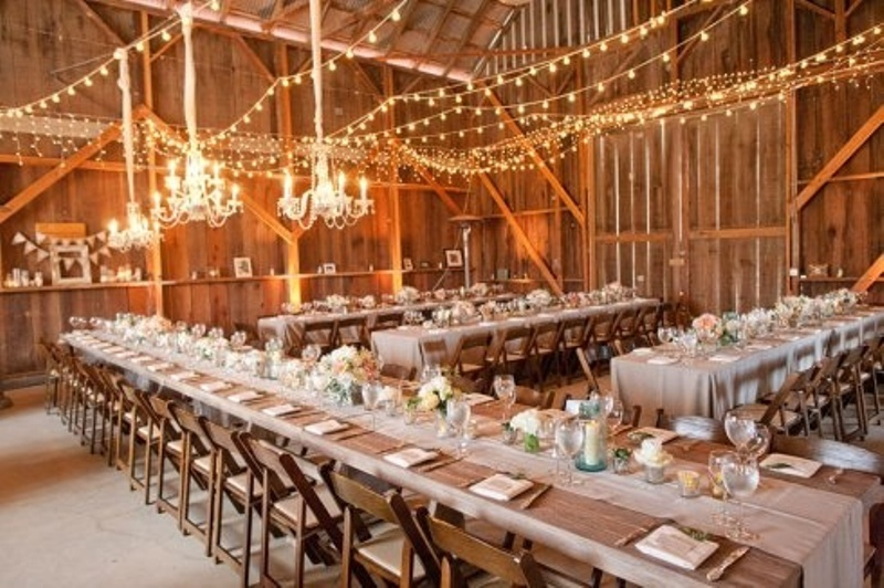 Rustic Wooden Tables With Neutral Fabric Runners White Candles And Bloom Centerpieces