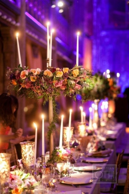 colorful blooms, tall and thin candles and mercury glass candle holders to illuminate long tables