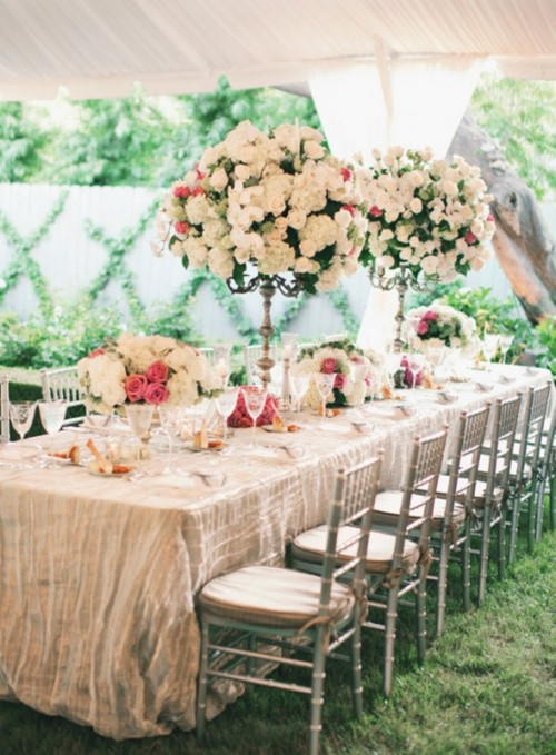 oversized floral topiaries and centerpieces make the tables very chic