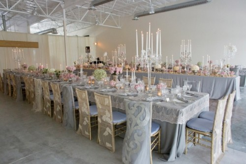 grey tables, pink and green blooms, candles and matching lace chair covers