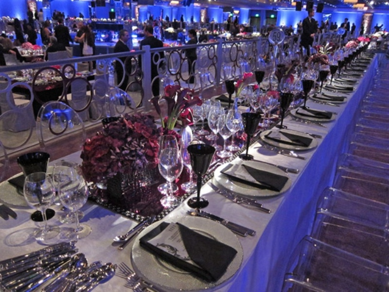 long fuchsia and burgundy bloom centerpieces and runners plus black glasses to contrast
