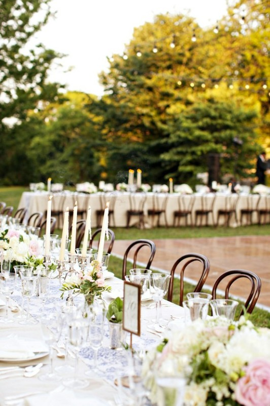 blue printed table runners, greenery and white and pink bloom centerpieces