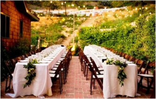 white tablecloths and greenery and bloom table runners for a timeless reception