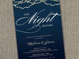 a navy rehearsal dinner invitation with white and gold letters and detailing is a lovely and elegant idea to enjoy