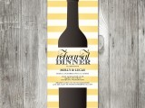 a colorful yellow and white striped rehearsal dinner invitation with a bottle printed for a vineyard rehearsal