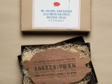 a creative rehearsal dinner invitation of a box covered in kraft paper, with straw and a wooden pig invitation for a BBQ rehearsal