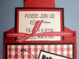 a bright red apron-shaped rehearsal dinner invitation with a plaid part and plaid ribbons