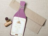 a stylish rehearsal dinner invitation styled as a purple wine bottle in a kraft paper envelope is a cool idea for a vineyard rehearsal