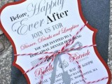 a whimsy rehearsal dinner invitation in white, grey, black and red with striped yarn and a black glitter envelope