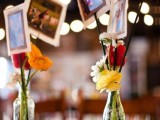 colorful floral centerpieces with the couple's photos are great for a rustic rehearsal