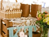 colorful wooden monograms and a basket with cutlery are what you need for a sweet rustic celebration