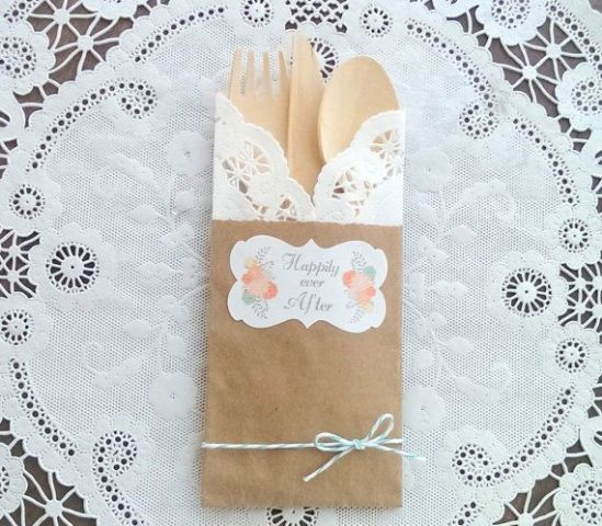 cardboard and craft paper bags with wooden cutlery for a rustic wedding or rehearsal