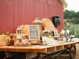 a table on wheels with hay, candle lanterns and chalkboard signs can be used to serve anything