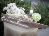 style your rehearsal dinner with wood, candle lanterns and hydrangeas