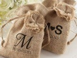 monogrammed burlap sacks to place favors inside or to make welcome bags