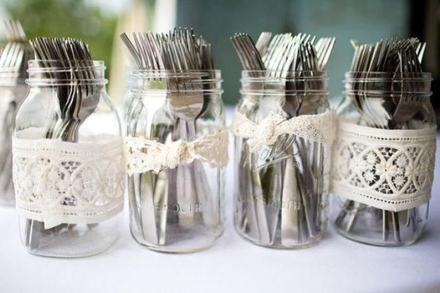 lace decorated jars with cutlery are right what you need for a rustic rehearsal