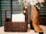 a basket with wishes and a cowboy boot with white blooms for a centerpiece