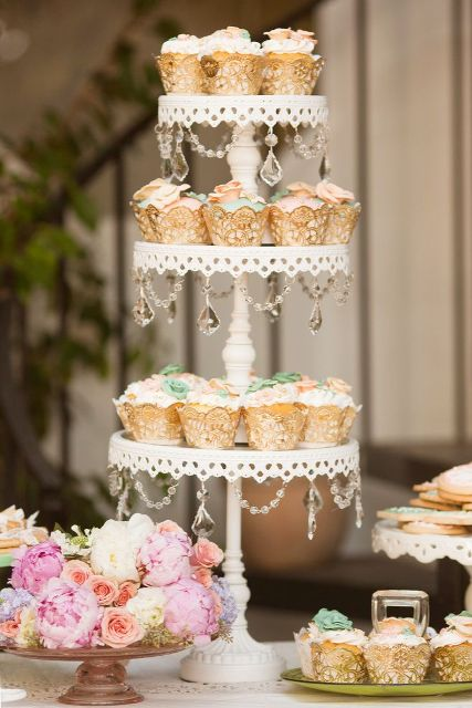 a refined metal laser cut wedding dessert stand with crystals for a romantic vintage wedding