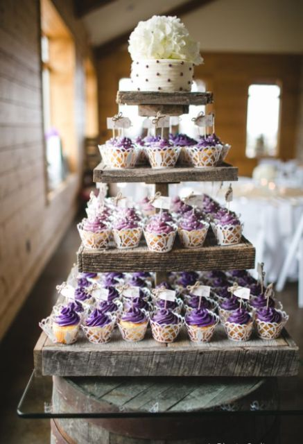 a reclaimed wood tiered sweets stand for both cupcakes and a wedding cake is a great solution for a rustic wedding