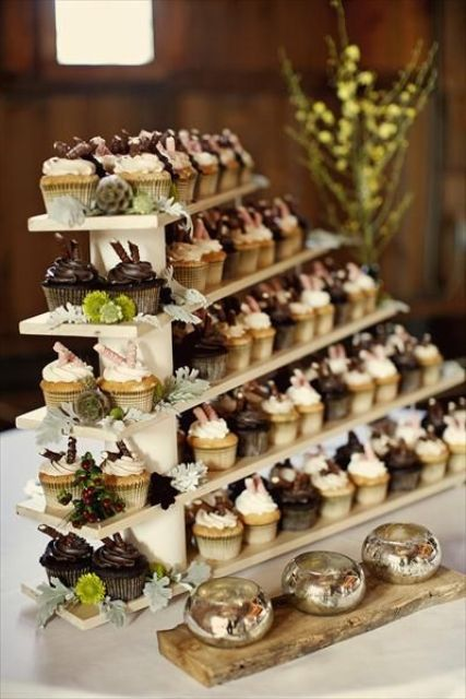 a simple modern wedding dessert stand with shelves and succulents, blooms and berries is a great idea for a modern wedding