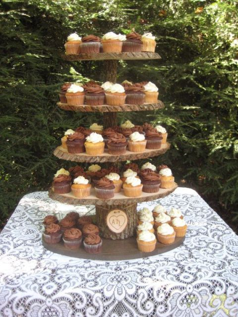 a cozy rustic wedding dessert stand of wood slices and a branch can be DIYed for a woodland or rustic wedding