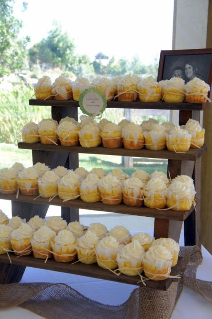 a rustic ladder-style wedding dessert stand with sweets and cupcakes is a simple and cool solution to rock