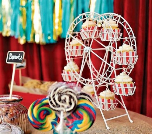 a cupcake stand shaped as a ferris wheel is a gorgeous idea for a fun and whimsical wedding