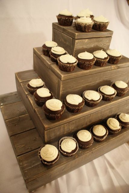a wooden box and plank stand for desserts is a great idea for a rustic wedding, it won't take any time to make it