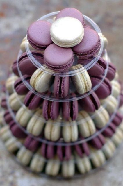 a simple sheer tiered plastic macaron stand is a lovely idea for a modern or a minimalist wedding