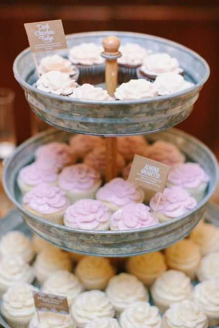 a galvanized metal tiered wedding sweets stand with sweets and cupcakes is a lovely idea for a rustic wedding