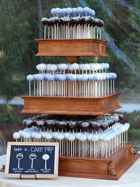 a tiered wood box stand is a great idea for cake pops, it allows to serve them right and at their best