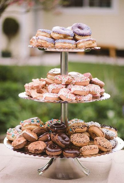 a stylish metal dessert stand with a ruffle edge will fit most of modern weddings and rustic ones, too