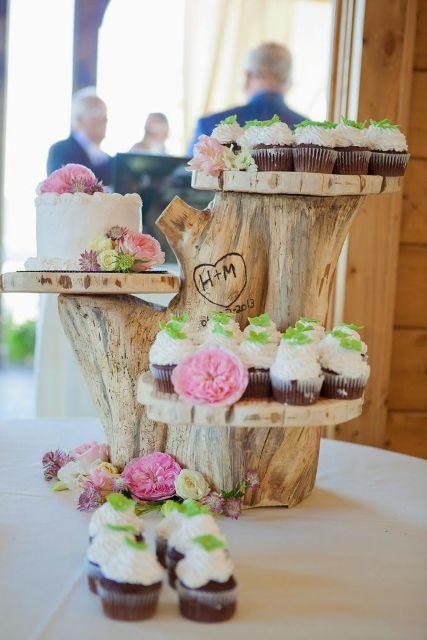 a woodland wedding dessert stand of tree stumps and wood slices for cupcakes and cakes is a lovely piece to DIY any time