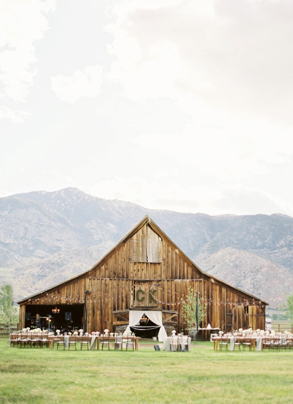 a barn with a mountain view is a great idea for a rustic yet adventuruous wedding, and the backdrop will be amazing