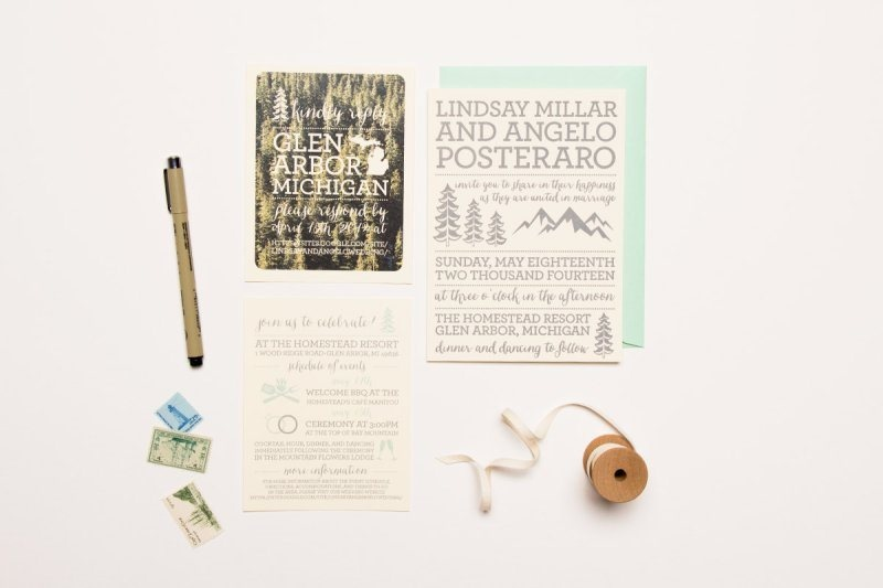 a stylish wedding invitation suite for a woodland wedding done in mint, grey and with woodland prints