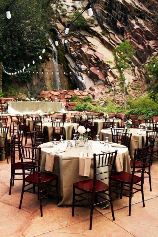 a stylish reception space right in the mountains, with a waterfall and lights over them