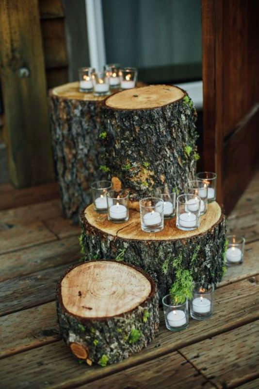 use tree stumps and candles for a woodland or rustic mountain wedding