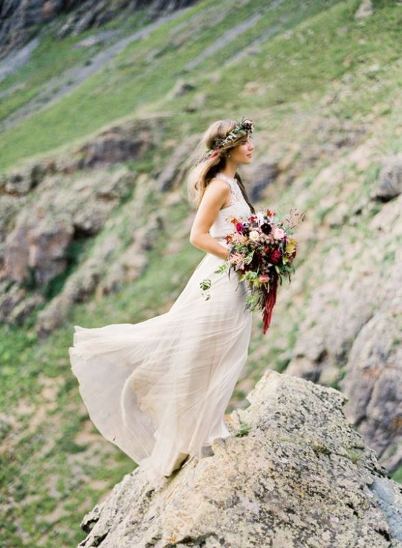 a gorgeous mountain bridal portrait with a wild fall colored bouquet and a matching floral crown