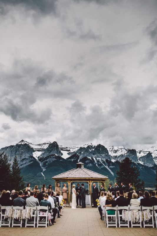 a beautiful wedding ceremony space with a gazebo and a beautiful view of the mountains