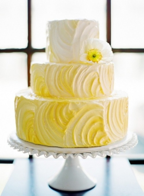 an ombre white to yellow textural wedding cake with a white bloom is a fun idea for a spring or summer wedding