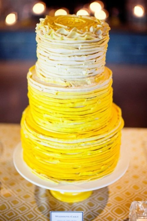 a bold ombre textural ruffled wedding cake from neutrals to deep yellows is a traditional and bold idea for a spring or summer wedding