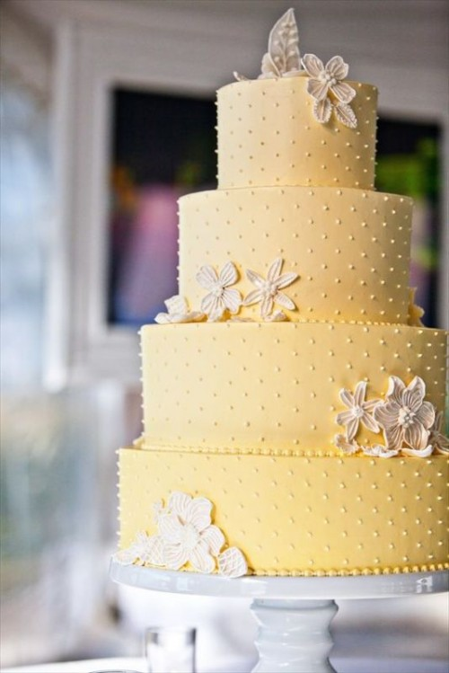 a yellow polka dot wedding cake with sugar blooms is a very cool and elegant idea for a bold spring or summer wedding