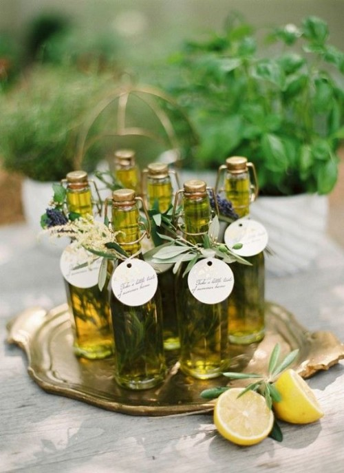 olive oil in bottles with olive foliage and tags on them are a nice wedding favor idea is a very cool and simple idea to rock