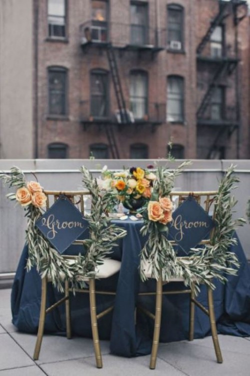 decorate the chairs with olive greenery and peachy blooms will accent your couple's chairs in a creative and chic way