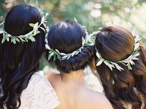 bridesmaids' crowns of olive foliage are a cool and natural idea for a every wedding