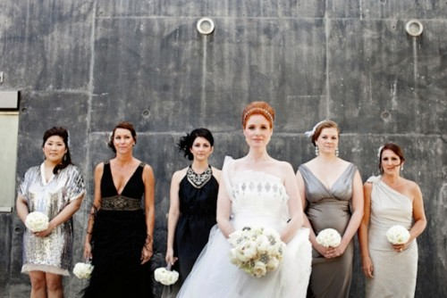 aboslutely mismatched black and grey bridesmaid dresses done with elegance and chic for an art deco wedding